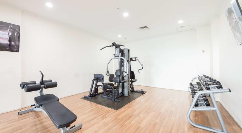 fasilitas gym apartemen signature park